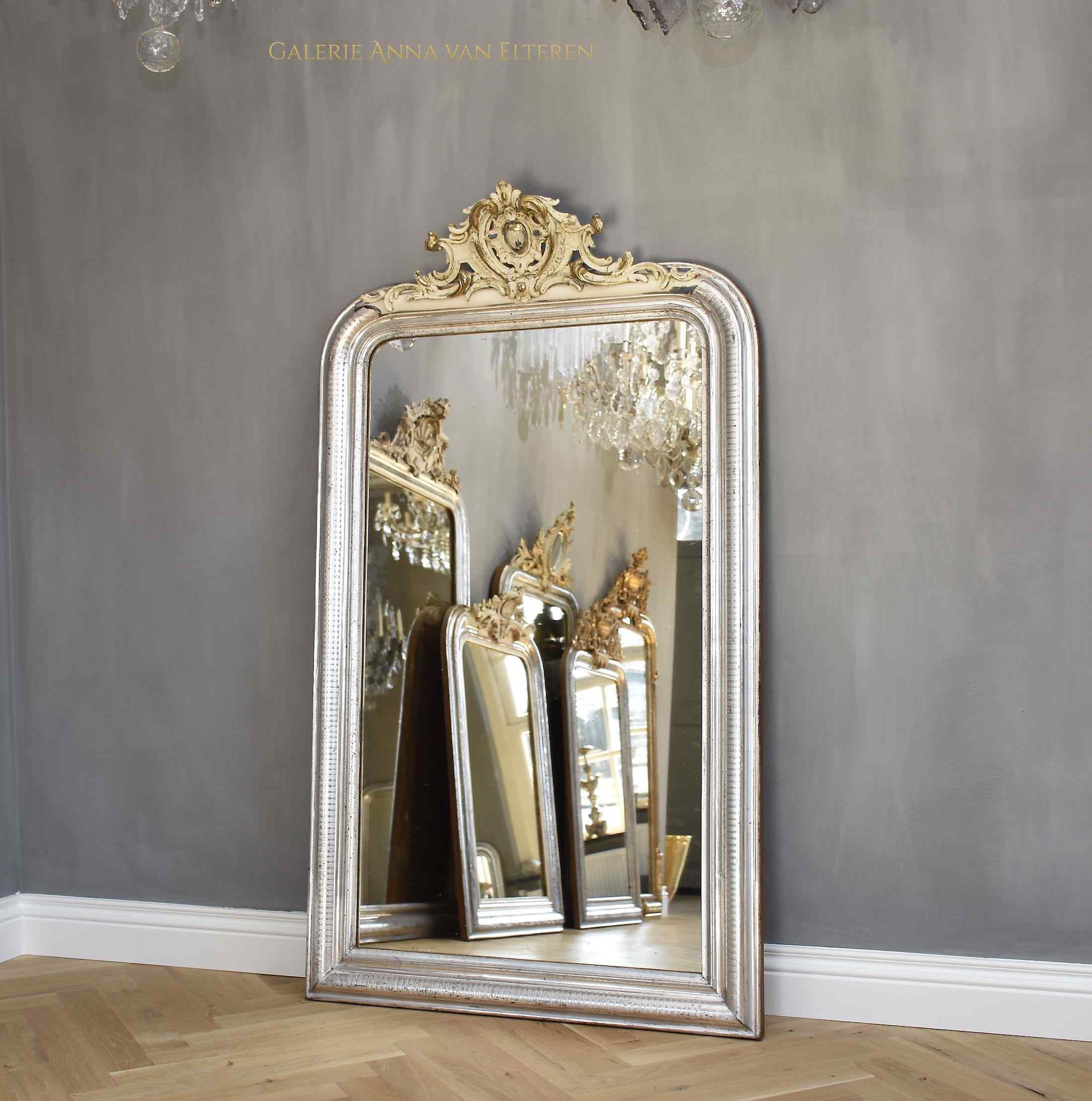 Large antique carved and gilded French mirror with a crest