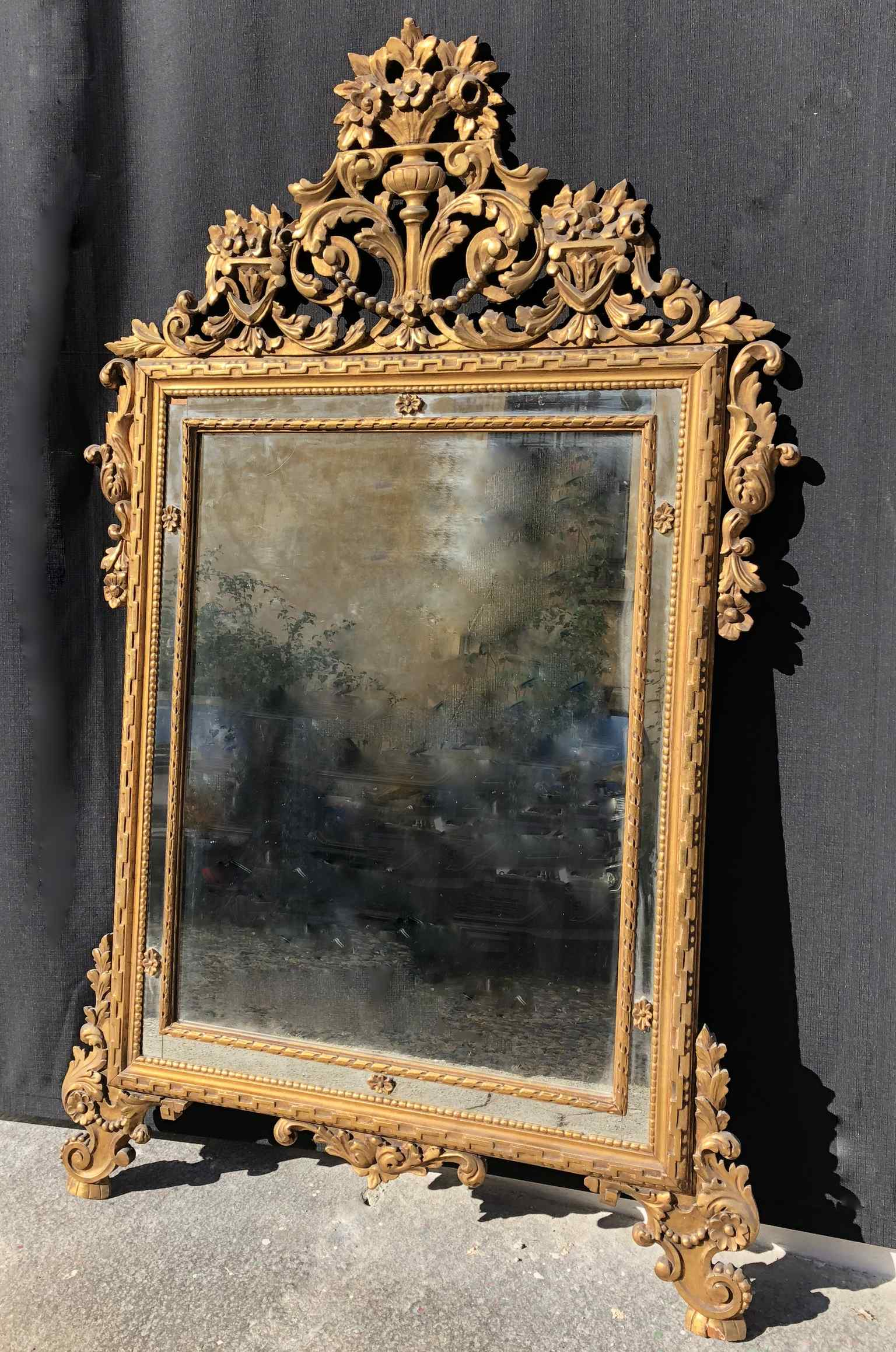 Louis XVI style carved and gilded wood mirror