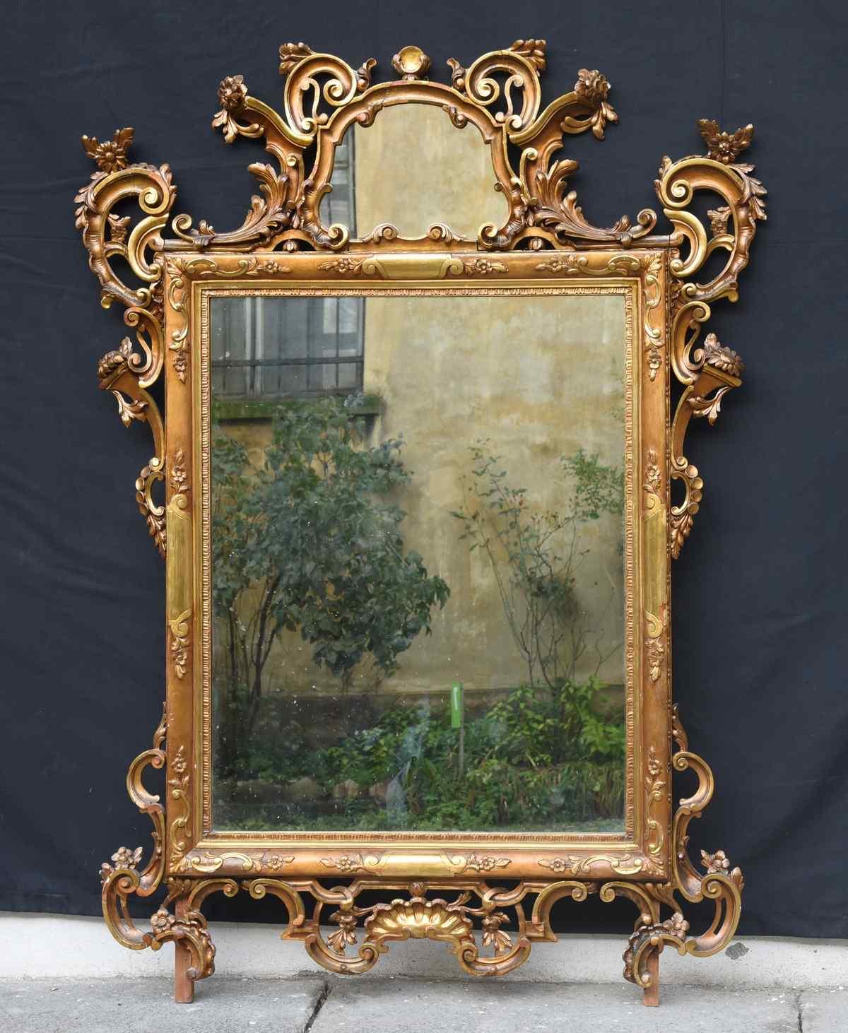 Antique 20th century mirror in Louis XVI style