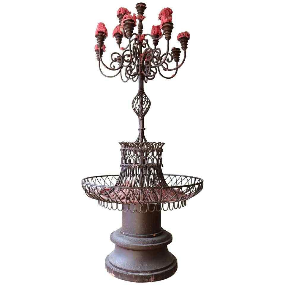 Grand candélabre ancien en fer et socle en terre cuite