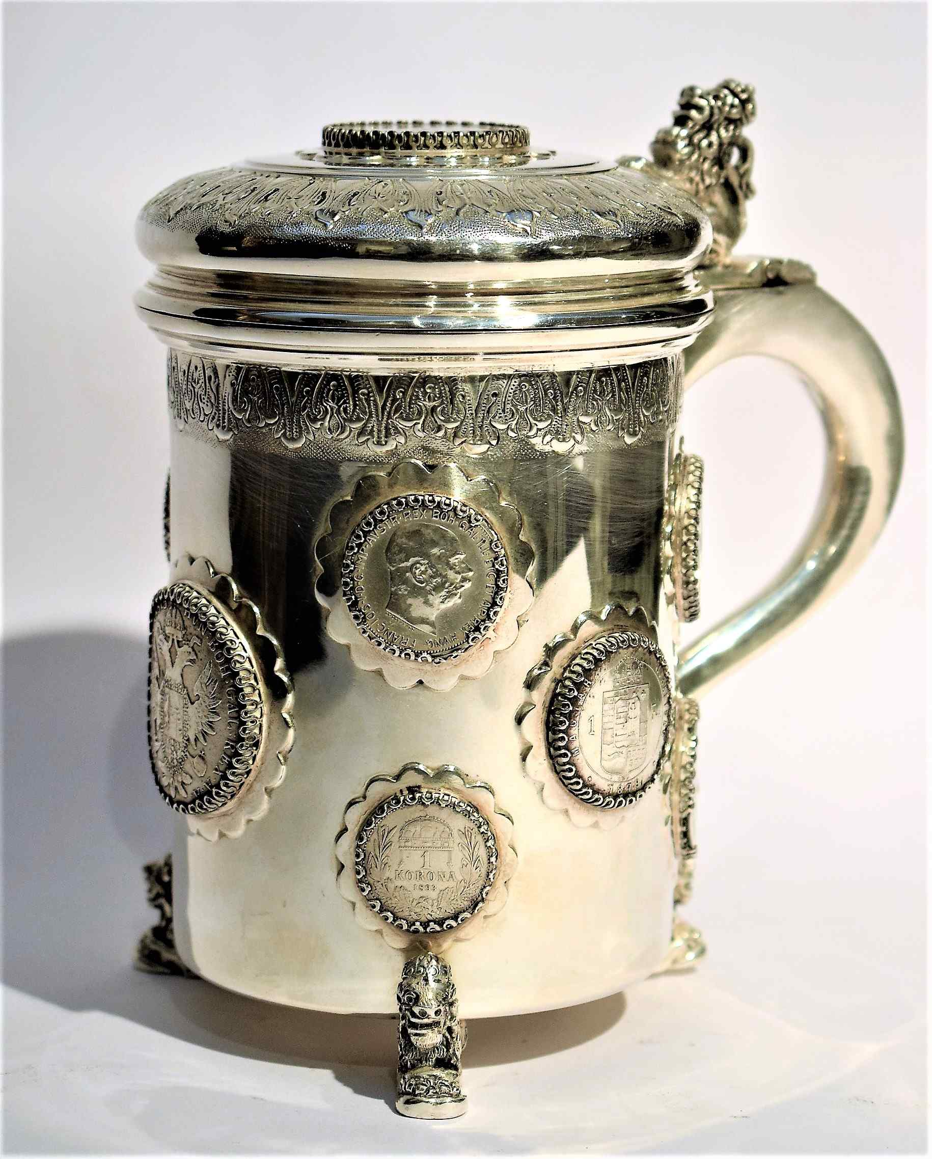 Silver tankard with Austro-Hungarian Empire coins.
