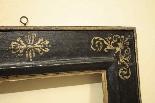 Ebony frame with golden decorations, sec. XVII-3