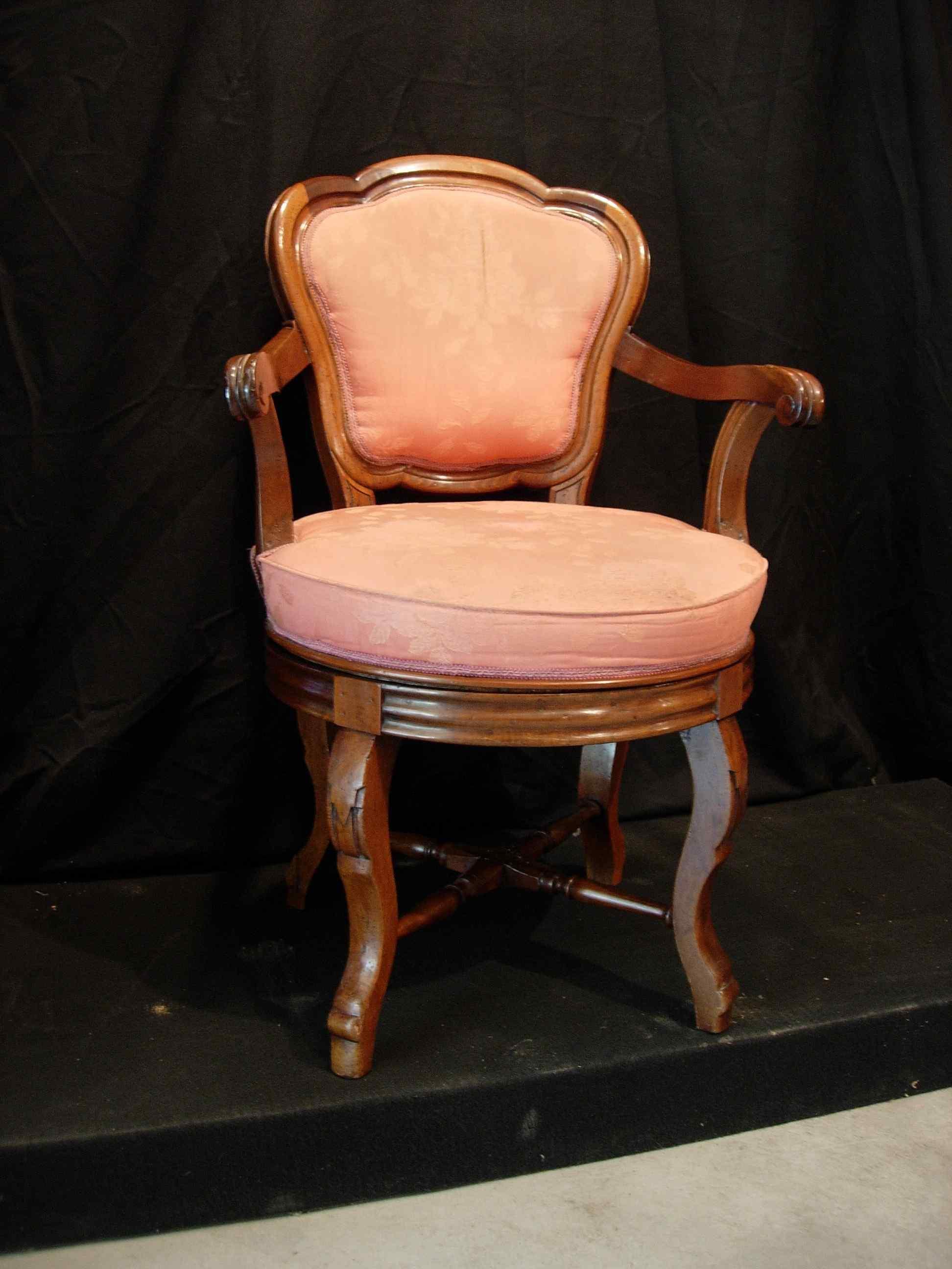 Swivel armchair in walnut wood