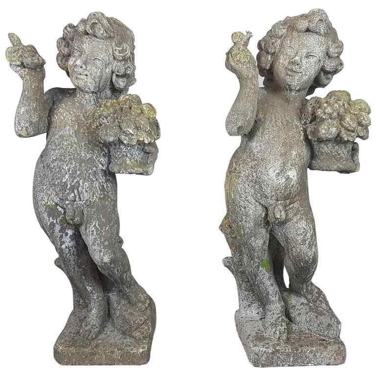 Paire de statues de jardin putti premier semestre XX